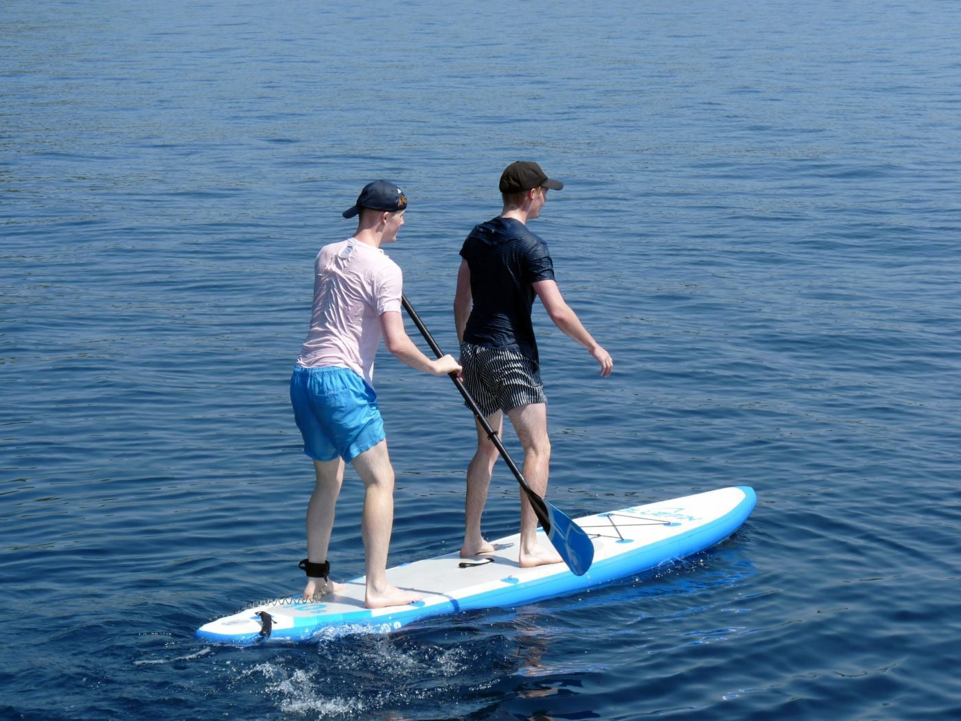 Activity Holidays Greece 2 guys tandem paddle on SUP