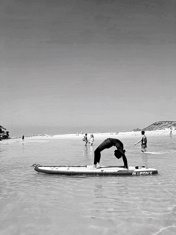 Bluefin SUP Yoga backbend in sports hijab