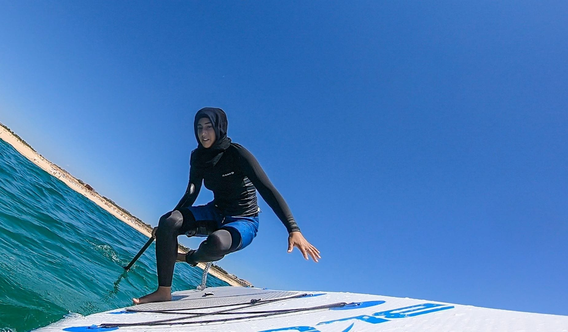 Sports hijab and modest swimwear in paddle boarding