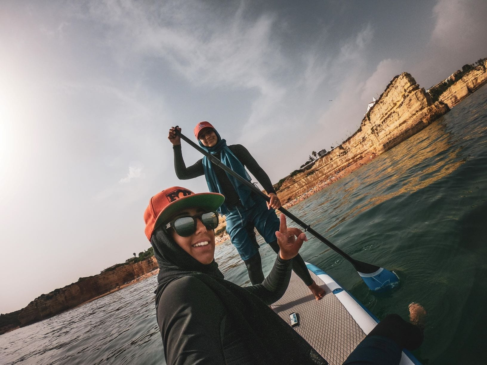 Yasmeen and sister on bluefin SUP in Portugal
