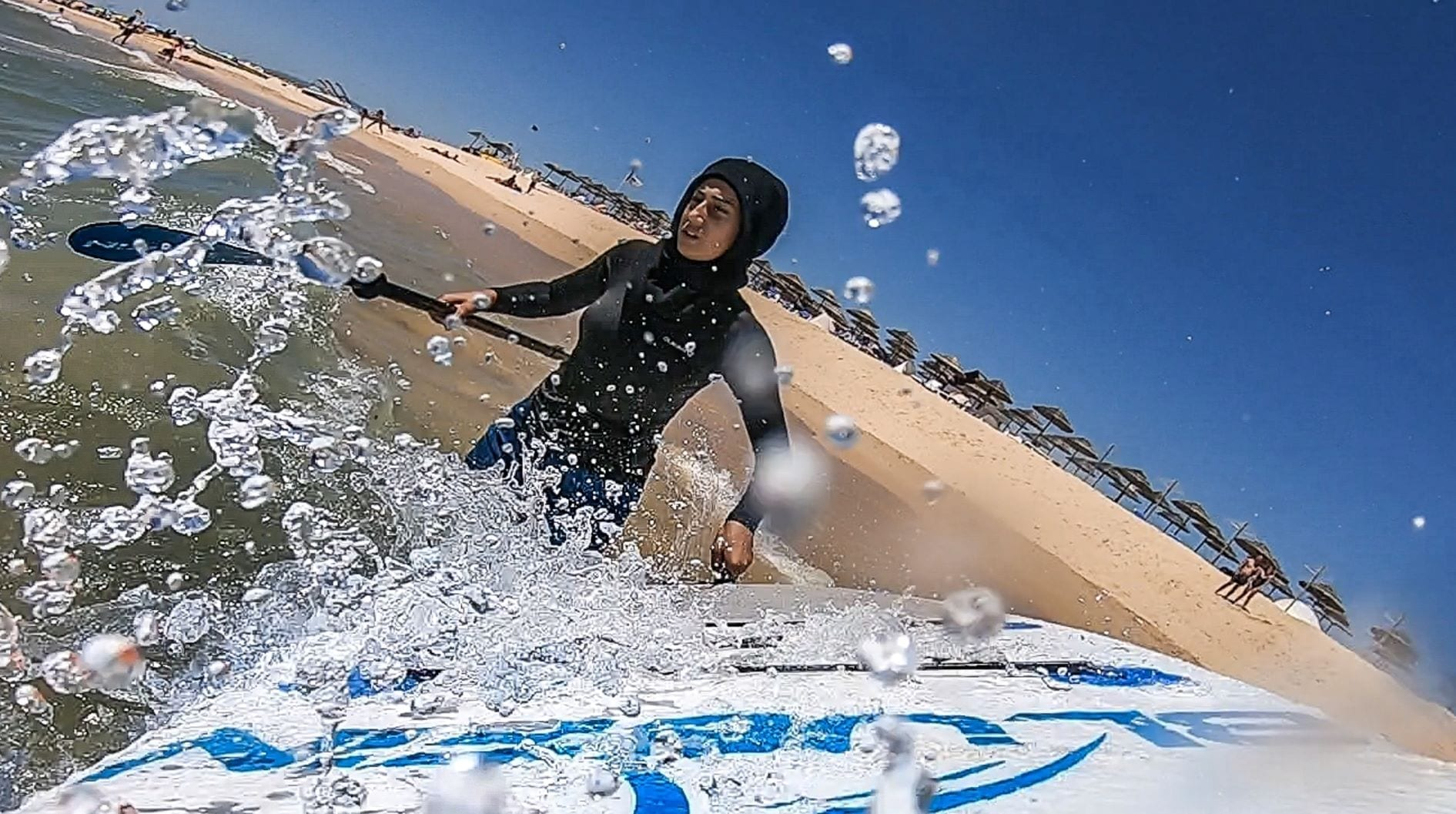 Yasmeen with paddleboard in sports hijab