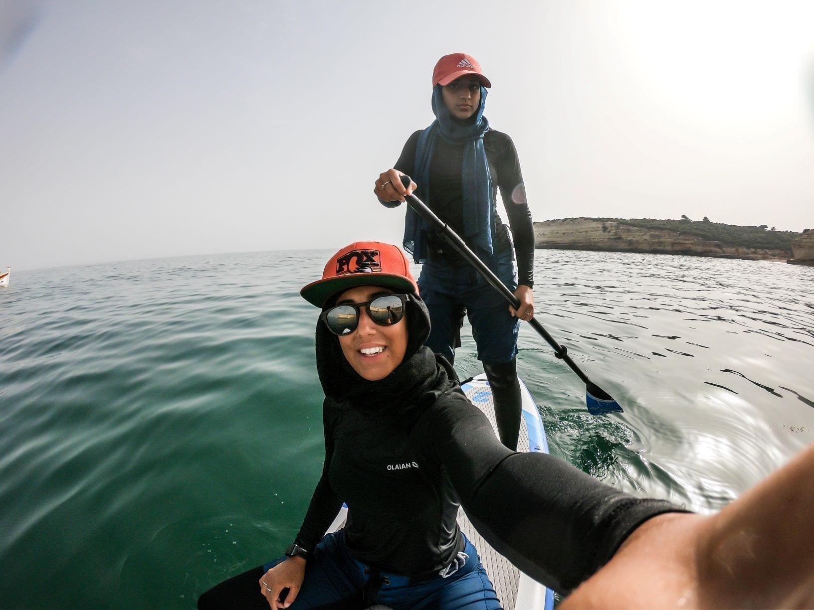 sisters in modest swimwear Bluefin paddleboard ummah