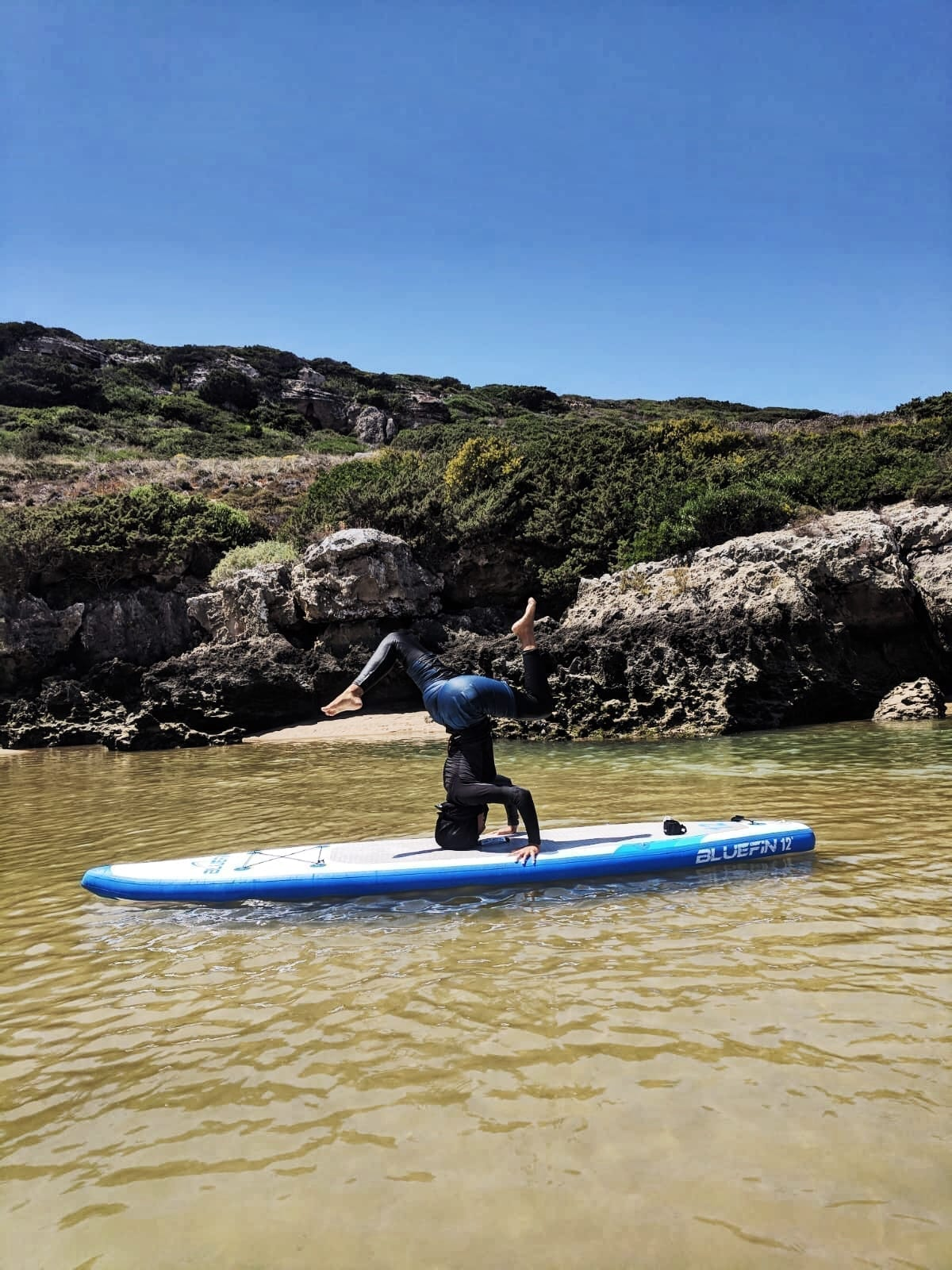 yoga headstand on Bluefin paddleboard
