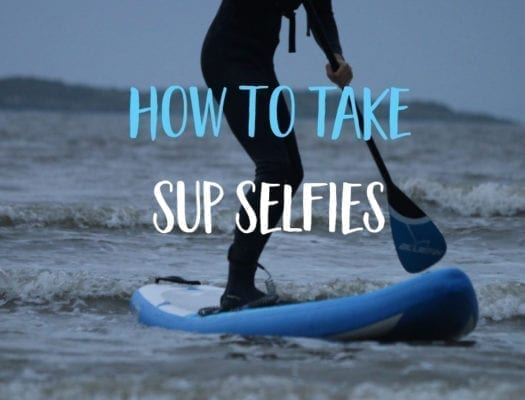 How to take better selfies - Guy in wetsuit paddling SUP into shore