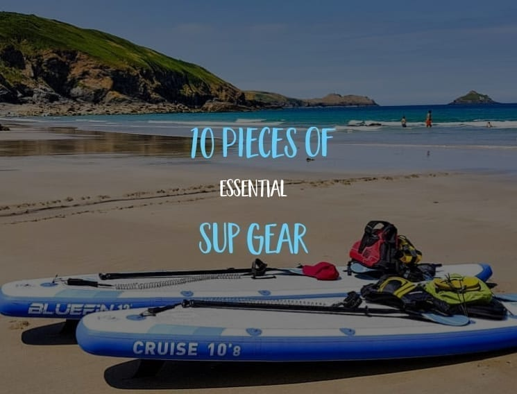 10 pieces of essential SUP gear boards on the beach