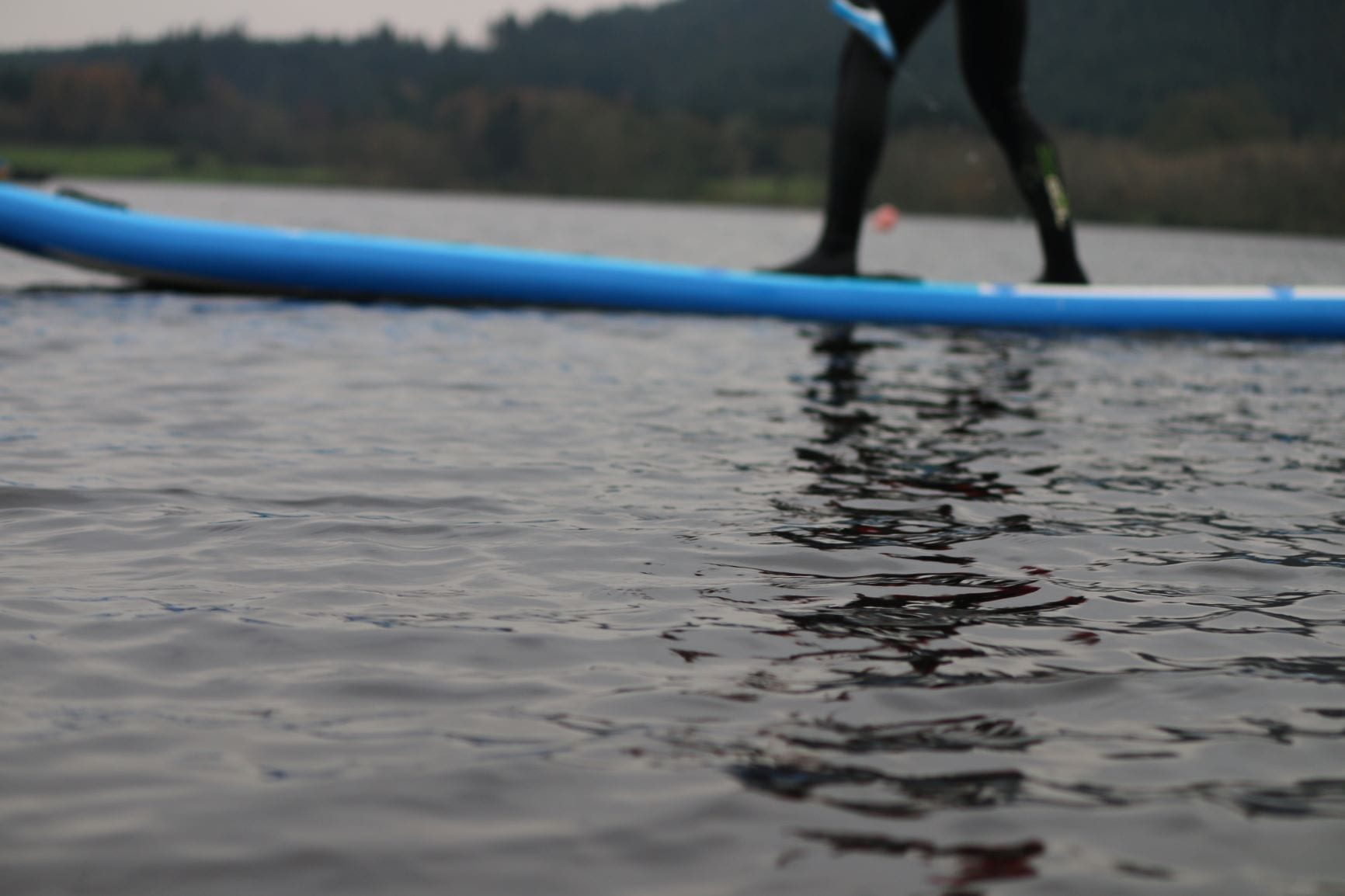 light reflecting on the water by paddleboard