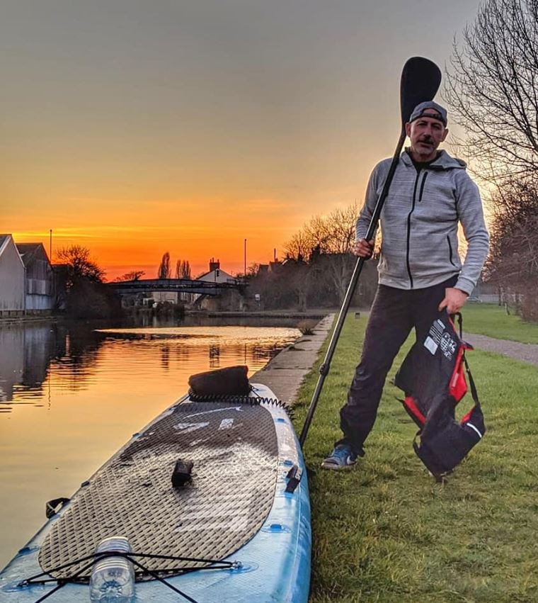 jason elliot at sunset on bluefin sprint in desmond family canal